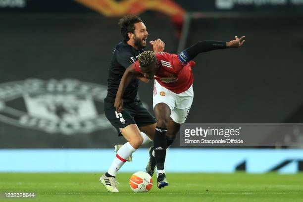 German Sanchez of Granada is fouled by Paul Pogba of Manchester United as he catches his face with his arm during the UEFA Europa League Quarter...