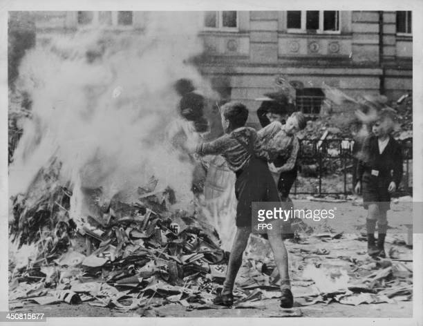 German school children burning Nazi books and paraphernalia following the end of World War Two Cologne Germany circa 19451948