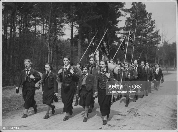 German school children marching through a forest as part of practice military games, as part of Hitler Youth during World War Two, Germany, circa...
