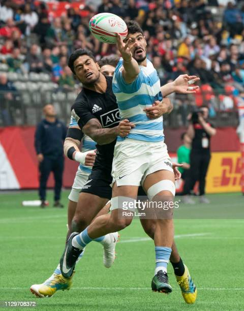 German Schulz of Argentina loses control of the ball after getting tackled by Regan Ware of New Zealand battle for the ball during rugby sevens...