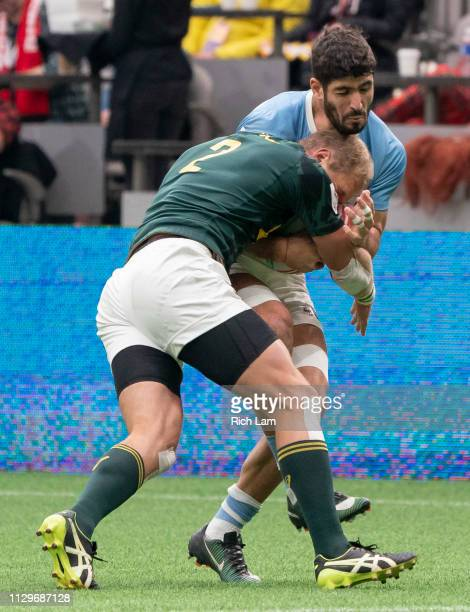 German Schulz of Argentina reacts as he is hit by Philip Snyman of South Africa during rugby sevens action on Day 2 of the HSBC Canada Sevens at BC...