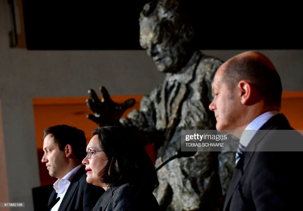 German secretary-General of the Social Democratic Party (SPD) Lars Klingbeil, Parliamentary group leader of the Social Democratic Party Andrea Nahles and Hamburg's mayor and politician of the Social Democratic Party Olaf Scholz give a statement at the SPD headquarters in Berlin, on February 13, 2018. Germany's chaos-wracked Social Democrats on February 13 approved Nahles' candidacy to become their new Party leader. The new leader will be elected on April 22, during a SPD meeting. / AFP PHOTO / Tobias SCHWARZ