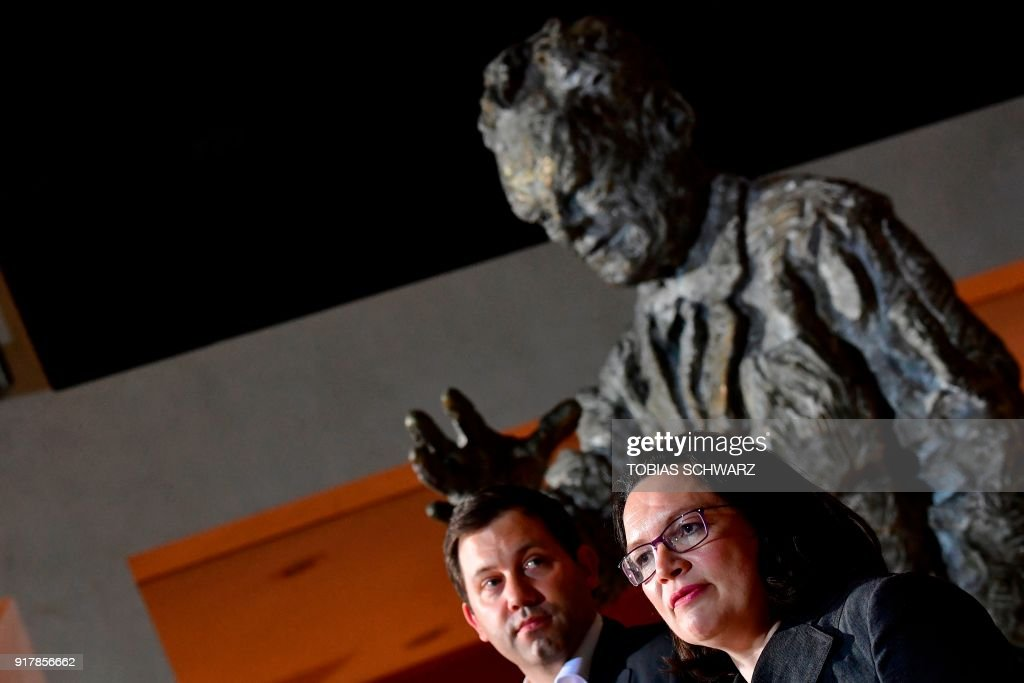 German secretary-General of the Social Democratic Party (SPD), Lars Klingbeil (L) and Parliamentary group leader of the Social Democratic Party, Andrea Nahles give a statement at the SPD headquarters in Berlin, on February 13, 2018. Germany's chaos-wracked Social Democrats on February 13 approved Nahles' candidacy to become their new Party leader. The new leader will be elected on April 22, during a SPD meeting. / AFP PHOTO / Tobias SCHWARZ