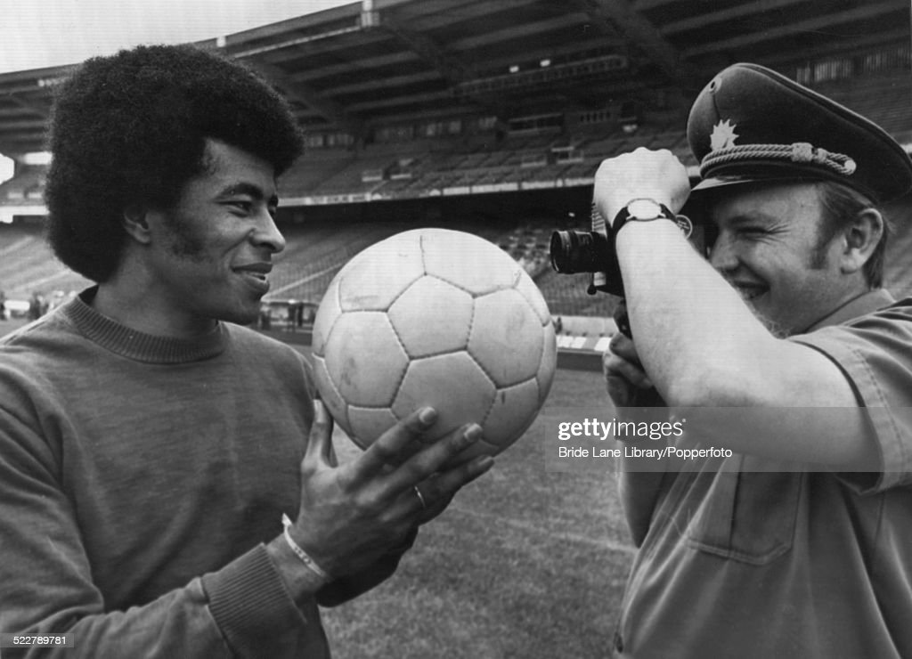 A German security guard films Brazilian footballer Jairzinho during a training session at the Parkstadion, Gelsenkirchen, during the FIFA World Cup tournament, Germany, 20th June 1974.