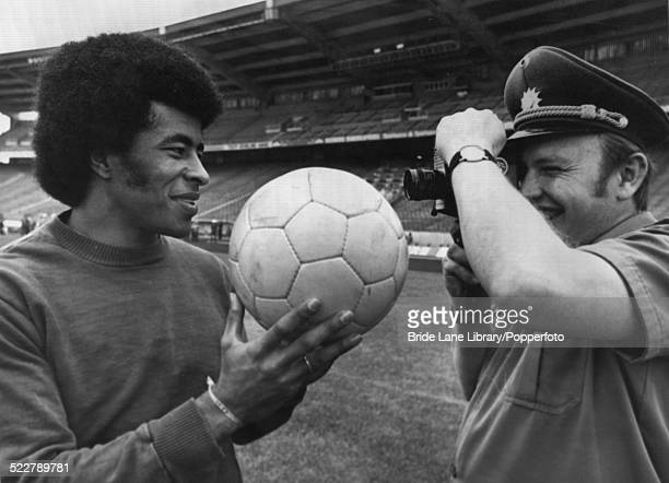 A German security guard films Brazilian footballer Jairzinho during a training session at the Parkstadion Gelsenkirchen during the FIFA World Cup...