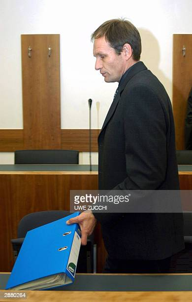 German selfconfessed cannibal Armin Meiwes arrives in the court room for his trial for having killed and eaten a man BerndJuergen Brandes 19 January...