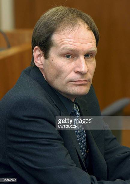 German selfconfessed cannibal Armin Meiwes waits for the start of his trial for having killed and eaten a man BerndJuergen Brandes 19 January 2004 at...