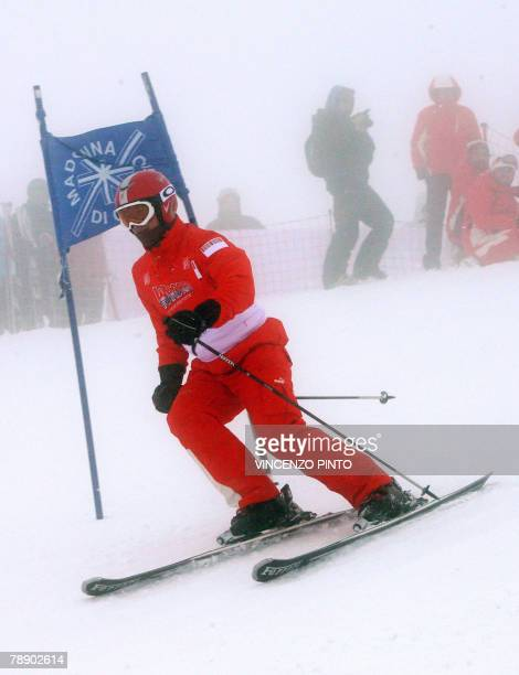 German seventime world champion Michael Schumacher speeds down the race during the Wrooom F1 and MotoGP Press Ski Meeting Ducati and Ferrari annual...