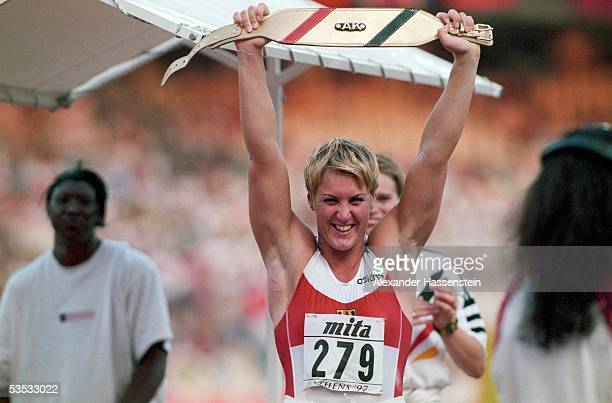 German shot putter Astrid Kumbernuss celebrates after winning the gold medal during the Athletics World Championships 1997 on August 9, 1997 in...