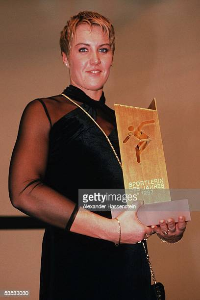 German shot putter Astrid Kumbernuss poses after winning the award of the German athlete of the year 1997 on December 7, 1997 in Ludwigsburg, Germany.