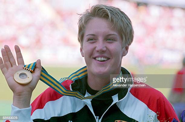German shot putter Astrid Kumbernuss shows her gold medal during the Athletics World Championships 1995 on August 7, 1995 in Goteborg, Sweden.