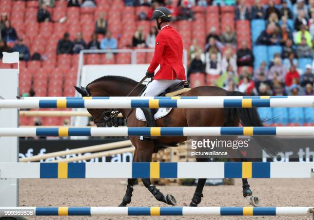 German show jumper Maurice Tebbel on his horse Chacco's Son is disappointed after his performance at the Show Jumping Team Event of the FEIEuropean...