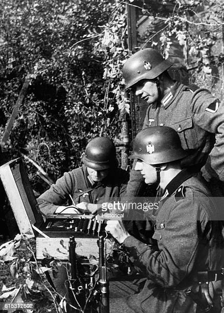 German Signal troops communicate by using what is described as a teletype but which actually resembles the Enigma encoding machine