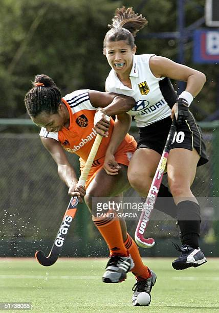German Silke Muller collides with Dutch Maartje Scheepstra during the field hockey match for the Champions Trophy in Rosario Argentina 13 November...