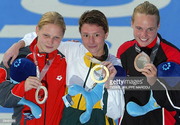 German silver medalist Conny Schmalfuss Australian gold medalist Irina Lashko and Canadian Blythe Hartley pose after the 1 meter springboard final at...