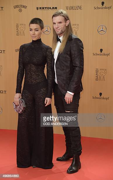 German singer Alina Sueggeler and musician Andi Weizel pose on the red carpet prior to the Bambi awards on November 12 2015 in Berlin The Bambis are...