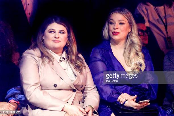 German singer Alina Wichmann aka Alina and German presenter/model Caterina Pogorzelski at the camel active show during Berlin Fashion Week...