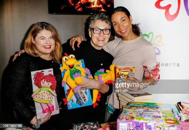 German singer Alina Wichmann alias Alina Rolf Scheider and German presenter Annabelle Mandeng wrap a present for children in need during the Laughing...