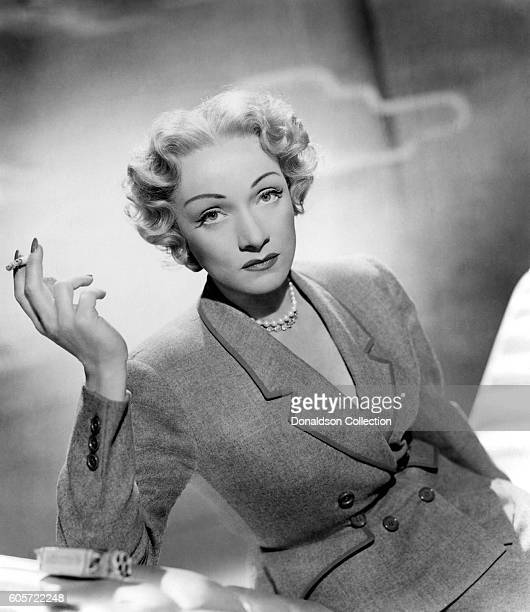 German singer and actress Marlene Dietrich poses for a portrait for the film 'Stage Fright' directed by Alfred Hitchcock in 1950