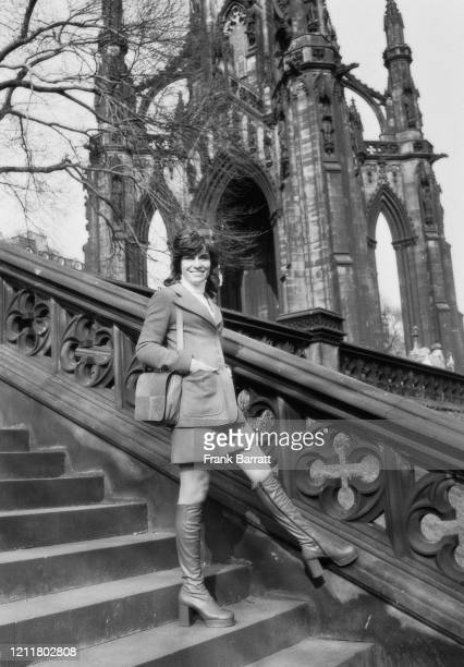 German singer and actress Mary Roos on a set of stairs in front of the Scott Monument in Edinburgh UK 25th March 1972