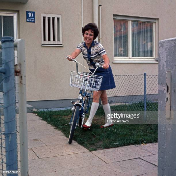 German singer and actress Monika Dahlberg in front of a house, Germany, 1960s.