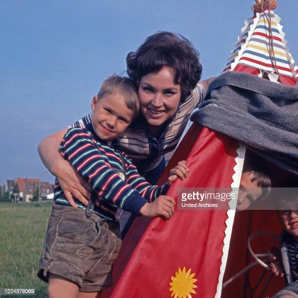 German singer and actress Monika Dahlberg playing with the children, Germany, 1960s.