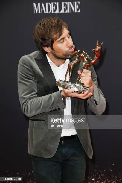 German singer and award winner Max Giesinger poses with award during the 71st Bambi Awards winners board at Festspielhaus BadenBaden on November 21...