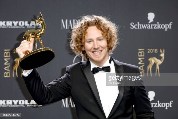 German singer and award winner Michael Schulte poses with award during the 70th Bambi Awards winners board at Stage Theater on November 16 2018 in...