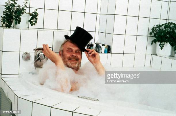 German singer and presenter being lazy with a cigar in his bathtub Germany circa 1995