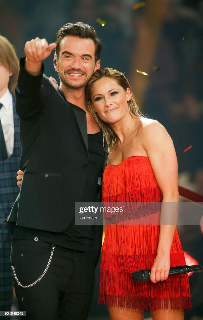 German singer and presenter Florian Silbereisen and his girlfriend German singer Helene Fischer during the 'Schlagerchampions - Das grosse Fest der Besten' TV Show at Velodrom on January 13, 2018 in Berlin, Germany.
