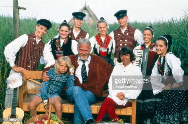 German singer and presenter Gunther Emmerlich with his family and musicians Germany circa 1994