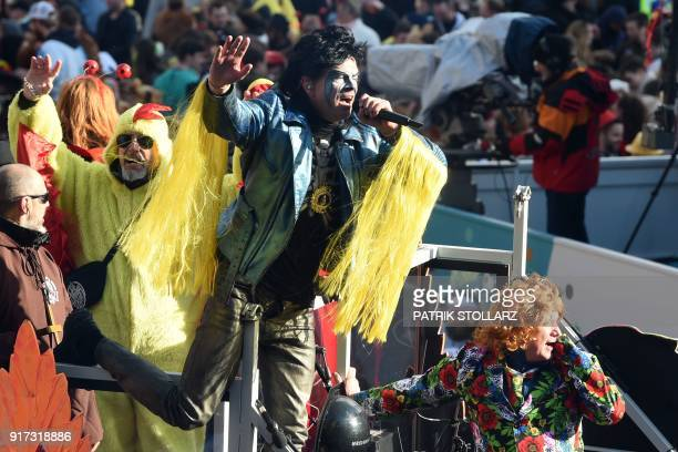 German singer and the lead vocalist of Die Toten Hosen German punk rock band Campino performs on a float during a carnival parade on Rose Monday on...