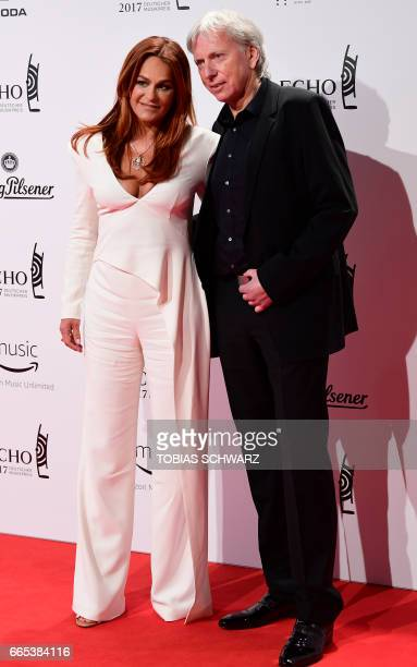 German singer Andrea Berg and husband Ulrich Ferber arrive for the 2016 Echo Music Awards in Berlin, on April 6, 2017. / AFP PHOTO / Tobias SCHWARZ