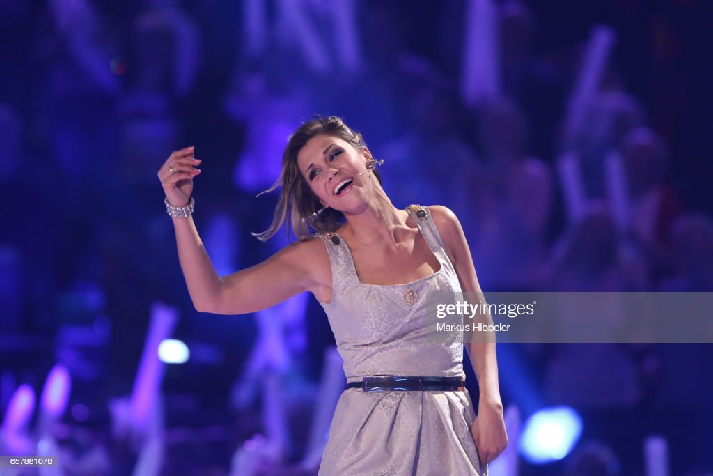 German singer Anna-Maria Zimmermann performs during the show 'Schlagercountdown - Das grosse Premierenfest' at EWE Arena on March 25, 2017 in Oldenburg, Germany.