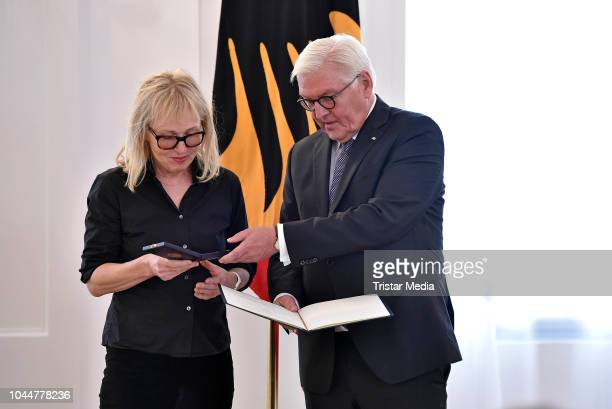 German singer Annette Humpe and german federal president FrankWalter Steinmeier during the awarding with the Order of Merit of the Federal Republic...
