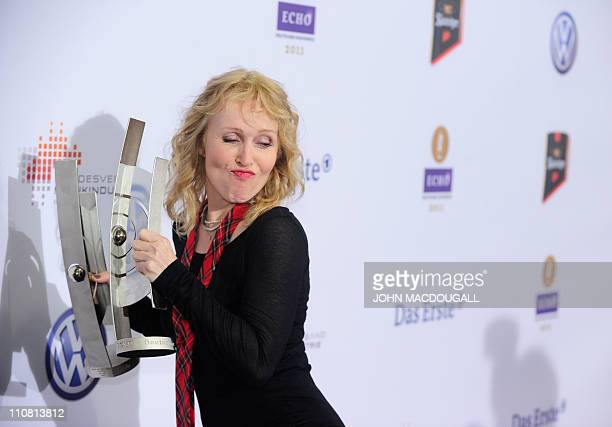 German singer Annette Humpe from the band 'Ich Ich' poses with her Echo received in the category 'Best National Rock/Pop group' at the 'Echo' music...