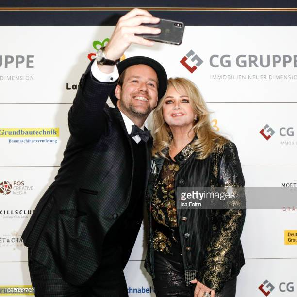 German singer Bernhard Bluemel alias Ben and British singer Bonnie Tyler during the 10th Laughing Hearts Charity Gala at Grand Hyatt Hotel on...