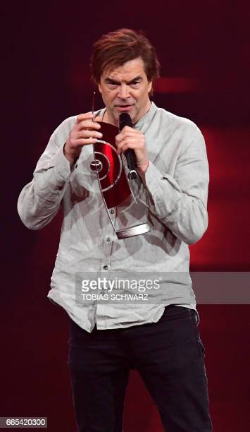 German singer Campino holds a speech before awarding the 'social engagement' proze during the 2017 Echo Music Awards in Berlin on April 6 2017 / AFP...
