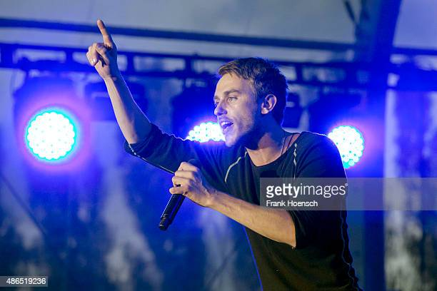 German singer Clueso performs live during a concert at the IFA Sommergarten on September 4 2015 in Berlin Germany
