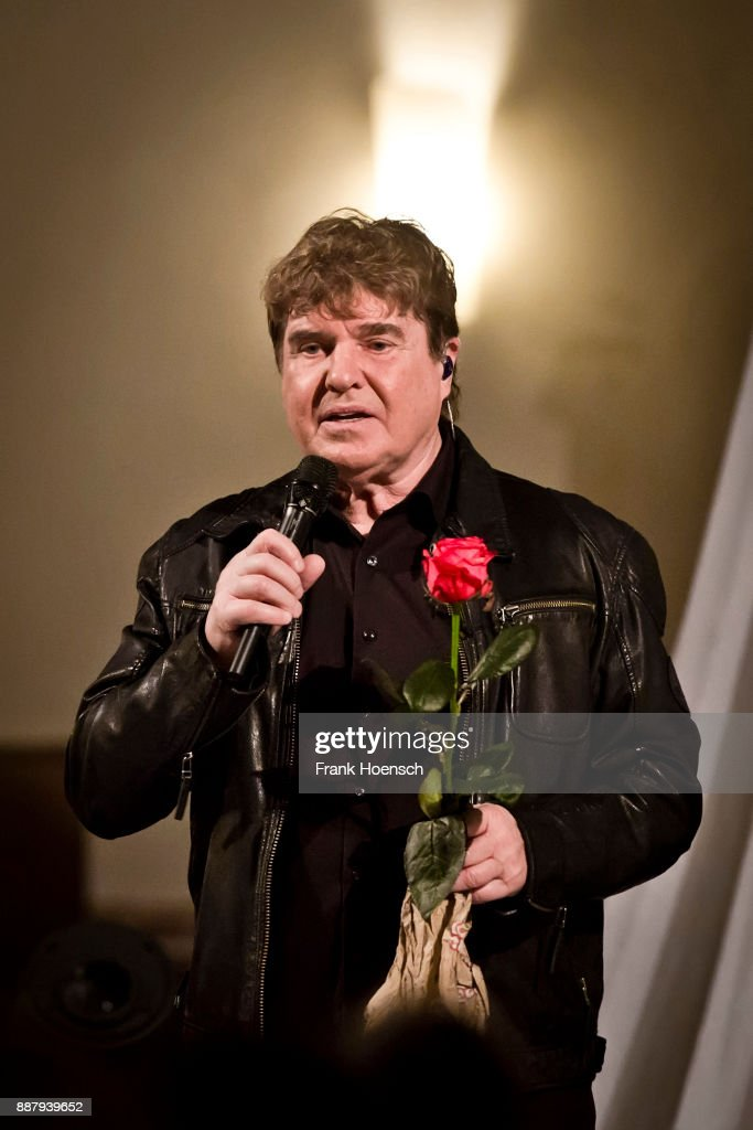German singer Frank Schoebel performs live on stage during a concert at the Gethsemanekirche on December 7, 2017 in Berlin, Germany.