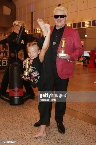 German Singer Heino poses with Kick chick challenge winner Samira Kindermann after he received the Lifetime Achievement Award Europe 2018 by Martial...