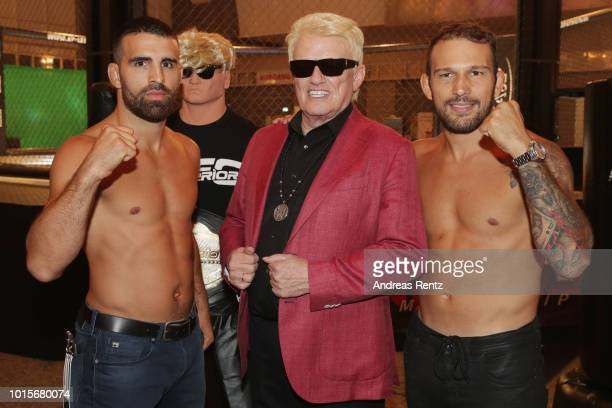 German Singer Heino poses with Mixed martial artists Daniel Weichel and Max Coga for a photograph after he received the Lifetime Achievement Award...