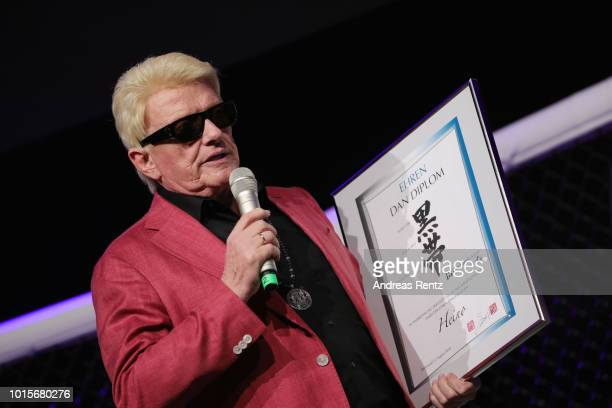 German Singer Heino receives a Dan diploma and the Lifetime Achievement Award Europe 2018 by Martial Arts Industry Association during the Martial...