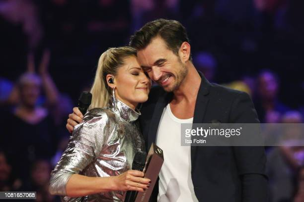 German singer Helene Fischer and German presenter Florian Silbereisen during the television show 'Schlagerchampions Das grosse Fest der Besten' at...