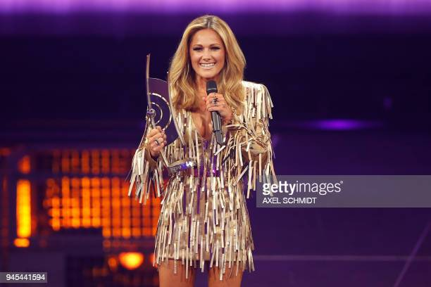 German singer Helene Fischer receive the Schlager award during the 2018 Echo Music Awards ceremony on April 12 2018 in Berlin / AFP PHOTO / AXEL...
