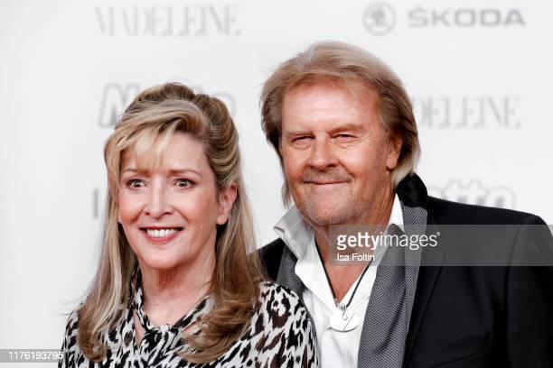 German singer Howard Carpendale and his partner Donnice Pierce attend the Goldene Henne at Messe Leipzig on September 20 2019 in Leipzig Germany