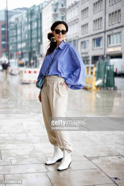 German singer Jasmin Wagner wearing a blue and white striped blouse Antonia by SoSUE, beige pants by LeGer by Lena Gercke, white boots by LeGer by...