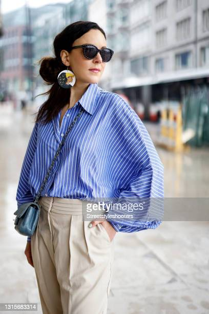 German singer Jasmin Wagner wearing a blue and white striped blouse Antonia by SoSUE, beige pants by LeGer by Lena Gercke, a light blue mini vintage...