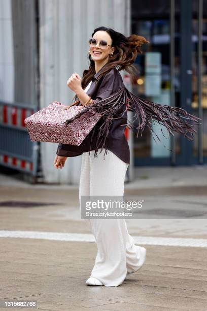 German singer Jasmin Wagner wearing a dark brown leather jacket with fringe detail by Zara, a cream colored bandeau top by Guido Maria Kretschmer,...