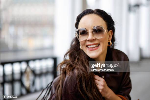German singer Jasmin Wagner wearing a dark brown leather jacket with fringe detail by Zara and sunglasses by Chloe during a street style shooting on...